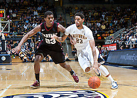 December 29th, 2012: California's Allen Crabbe tries to drive the ball around Harvard's Wesley Saunders during a game at Haas Pavilion in Berkeley, Ca Harvard defeated California 67 - 62