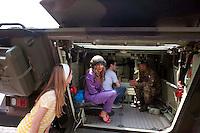 Roma 4  Maggio 2011. Mezzi militariin piazza Venezia per i 150° dell'anniversario della costituzione dell'Esercito Italiano..Visitatori all'interno di un blindato.