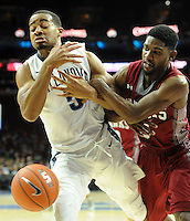 Villanova's (5) Phil Booth battles for a loose ball with IUP's Brandon Spain in the first half Saturday, November 5, 2016 at the Wells Fargo Center in Philadelphia, Pennsylvania. (WILLIAM THOMAS CAIN / For The Philadelphia Inquirer)