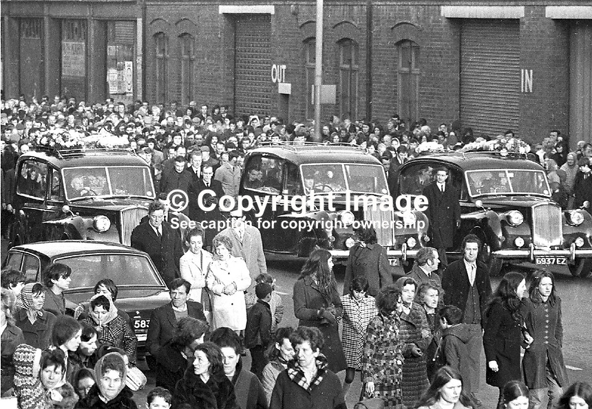 The funeral of victims of the McGurk's Bar explosion. Fifteen died in the blast, including the bar owner's wife and daughter, and 13 were injured. One of the injured subsequently died. NI Troubles. Ref: 19711207002..Copyright Image from Victor Patterson, 54 Dorchester Park, Belfast, UK, BT9 6RJ..Tel: +44 28 9066 1296.Mob: +44 7802 353836.Voicemail +44 20 8816 7153.Skype: victorpattersonbelfast.Email: victorpatterson@mac.com.Email: victorpatterson@ireland.com (back-up)..IMPORTANT: If you wish to use this image or any other of my images please go to www.victorpatterson.com and click on the Terms & Conditions. Then contact me by email or phone with the reference number(s) of the image(s) concerned.