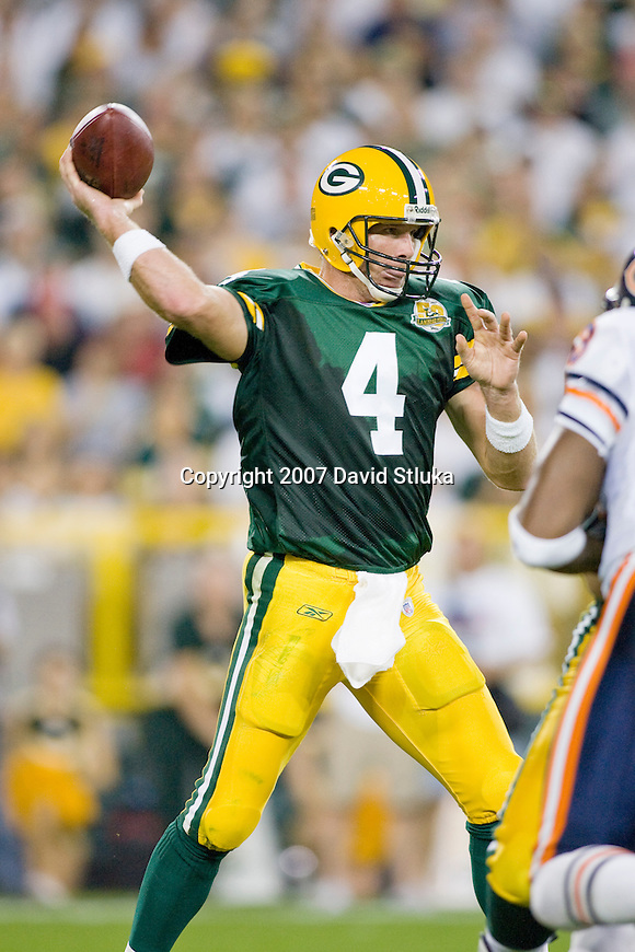 Quarterback Brett Favre #4 of the Green Bay Packers throws a pass during an NFL football game against the Chicago Bears at Lambeau Field on October 7, 2007 in Green Bay, Wisconsin. The Bears beat the Packers 27-20. (Photo by David Stluka)