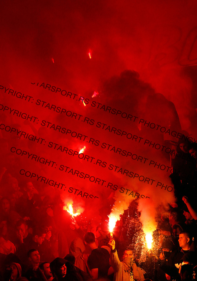 BELGRADE, SERBIA - MARCH 21: Supporters of FC Partizan Grobari with flairs during the Serbia's National Cup first leg  Semi final soccer match Red Star against Partizan in Belgrade, Serbia, 21 March 2012. Red Star won the match 2-0.  (Photo by Srdjan Stevanovic/Getty Images)