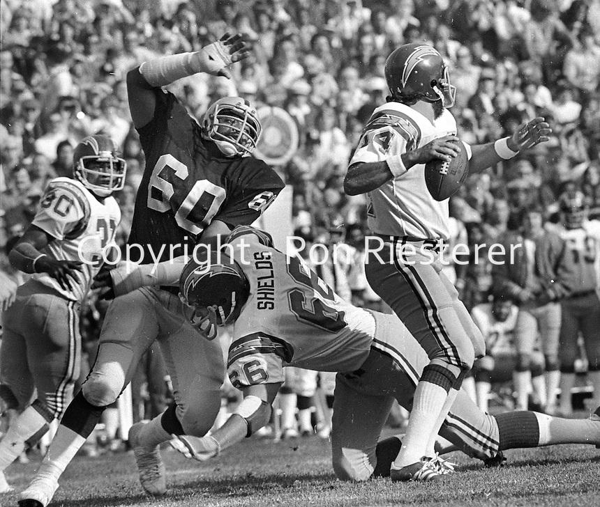 Oakland Raider Otis Sistrunk #60 after San Diego QB Dan Fouts, blocked by      Shields. (1976 photo/Ron Riesterer)