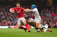 Pictured: George North of Wales is tackled by Tom Curry of England during the Guinness six nations match between Wales and England at the Principality Stadium, Cardiff, Wales, UK.<br /> Saturday 23 February 2019