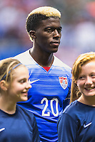 United States' forward Gyasi Zardes (20) during the singing of national anthem before an international friendly at the Alamodome, Wednesday, April 15, 2015 in San Antonio, Tex. (Mo Khursheed/TFV Media via AP Images)