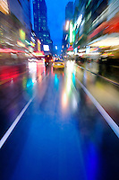42nd Street, Times Square, New York City on a rainy night.  Blurred motion image photographed with special camera mount from moving vehicle.