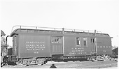 #62 baggage &amp; RPO car at Antonito.  Side view.  Handrail on roof.<br /> D&amp;RGW  Antonito, CO  Taken by Maxwell, John W. - 7/2/1941