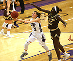 SIOUX FALLS, SD - NOVEMBER 25: Augusta Thramer #3 from the University of Sioux Falls takes the ball to the basket past Abuk Akoi #35 from Southwest Minnesota State University during their game Saturday evening at the Stewart Center in Sioux Falls. (Photo by Dave Eggen/Inertia)