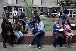BLOEMFONTEIN, SOUTH AFRICA APRIL 17, 2013: Students chat outside lecture halls at the University of the Free State in Bloemfontein, South Africa. Races are mixing more but often they socialize with their own kind. Photo by: Per-Anders Pettersson