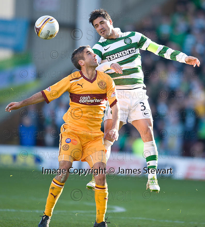 CELTIC'S BERAM KAYAL GETS ABOVE MOTHERWELL'S KEITH LASLEY