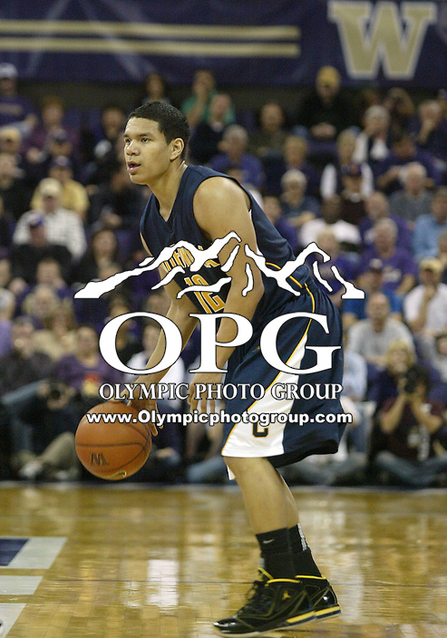 16 January 2010:  California point guard #12 Brandon Smith brings the ball down court against Washinton. Washington won 84-69 over California at the Bank of America Arena in Seattle, WA.