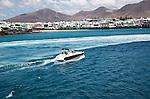 Motor boat leaving harbour at Playa Blanca, Lanzarote, Canary Islands, Spain