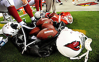 Aug. 28, 2009; Glendale, AZ, USA; Detailed view of an Arizona Cardinals helmet and Wilson footballs on the sidelines during the game against the Green Bay Packers during a preseason game at University of Phoenix Stadium. Mandatory Credit: Mark J. Rebilas-