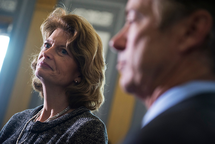 UNITED STATES - NOVEMBER 06: Sens. Lisa Murkowski, R-Alaska, and Rand Paul, R-Ky., arrive for a new conference in Russell Building on creating a military justice system that would lessen the intimidation that military sexual assault victims feel when coming forward about a crime committed against them. (Photo By Tom Williams/CQ Roll Call)