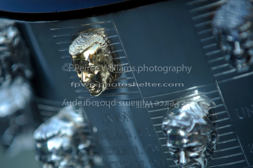 The likeness of  Indianapolis Motor Speedway owner Anton Hulman, Jr.  on the Borg-Warner Trophy. This is the only likeness rendered in gold on the silver trophy.