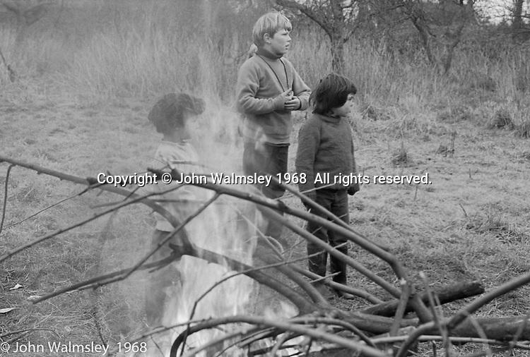 Lighting smokey bonfires in the grounds, Summerhill school, Leiston, Suffolk, UK. 1968.
