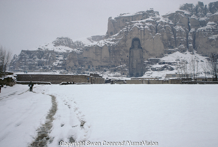 The Bamiyan Buddha of 54 meters high, in winter 1995..These magnificent colossal statues, created during the 3rdâ4th centuries A.D., attracted pilgrims for centuries, far beyond the time when Buddhism languished in India following the disastrous visitation of the Hephthalite Huns in the 5th century, the subsequent resurgence of Hinduism, and the arrival of iconoclastic Islam in the 7th century..The entire niche was once covered with paintings dating from i he late 5th to the early 7th centuries.