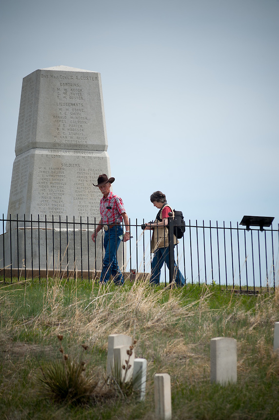 Tourists stroll Thrusday, May 16, 2013, past the markers on Last Stand Hill, where George Armstrong Custer met his end, June 25, 1876. The Little Bighorn Battlefield National Monument sits on the Crow Reservation in southern Montana. Pending new ports for shipment to Asia through either the U.S. or Canada, Cloud Peak Energey hopes to open new high-grade coal mines on and near the Crow Reservation in southern Montana. The tribe is equally hopeful the new mines would bring long-awaited economic stability to the tribe. (Kevin Moloney for the New York Times)