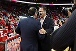 25 January 2015: NC State head coach Mark Gottfried (right) and Notre Dame head coach Mike Brey (left) shake hands before the game. The North Carolina State University Wolfpack played the University of Notre Dame Fighting Irish in an NCAA Division I Men's basketball game at the PNC Arena in Raleigh, North Carolina. Notre Dame won the game 81-78 in overtime.