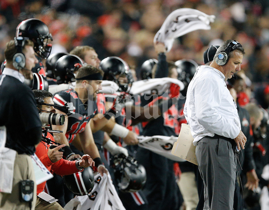 Ohio State Buckeyes head coach Urban Meyer talks to coaches on his headset during the first half of the NCAA football game against the Penn State Nittany Lions at Ohio Stadium in Columbus on Oct. 17, 2015. Ohio State won 38-10. (Adam Cairns / The Columbus Dispatch)