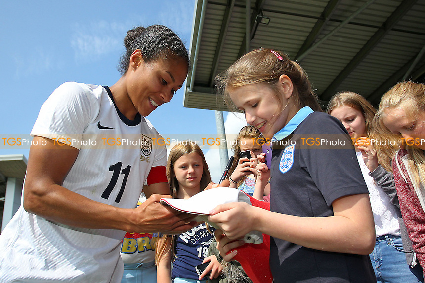 Rachel Yankey signs autographs for the fans after winning her record 126th cap for England - England Women vs Japan Women - Friendly Football International at the Pirelli Stadium, Burton Albion FC - 26/06/13 - MANDATORY CREDIT: Gavin Ellis/TGSPHOTO - Self billing applies where appropriate - 0845 094 6026 - contact@tgsphoto.co.uk - NO UNPAID USE