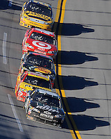 Nov. 1, 2009; Talladega, AL, USA; NASCAR Sprint Cup Series driver Dale Earnhardt Jr (88) leads Kevin Harvick (29) and Martin Truex Jr (1) during the Amp Energy 500 at the Talladega Superspeedway. Mandatory Credit: Mark J. Rebilas-