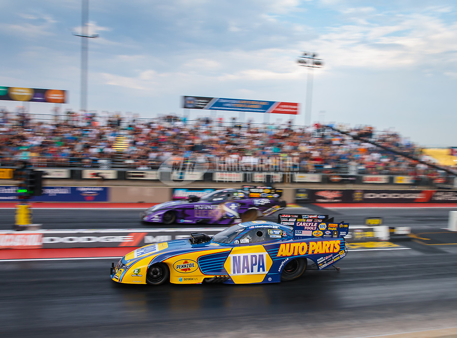 Jul 20, 2018; Morrison, CO, USA; NHRA funny car driver Ron Capps (near) races alongside Jack Beckman during qualifying for the Mile High Nationals at Bandimere Speedway. Mandatory Credit: Mark J. Rebilas-USA TODAY Sports