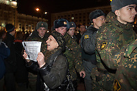 Moscow, Russia, 31/10/2010..A demonstrator and soldiers at the first Strategy 31 anti-government demonstration to be permitted after all previous such demonstrations were broken up by police. Opposition activists hold regular demonstrations on the 31st day of the month, protesting against restrictions on the freedom of assembly, which is protected by article number 31 of the Russian constitution.