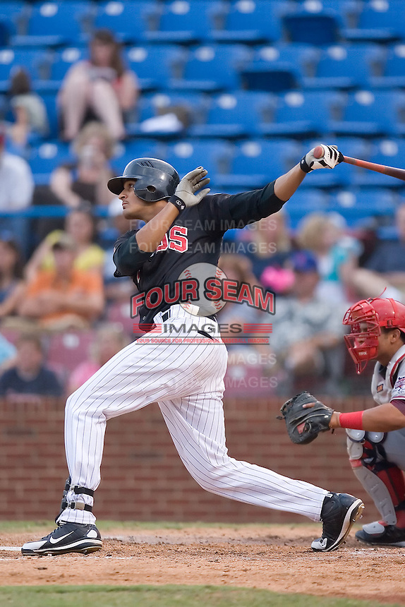 Salvador Sanchez (41) of the Winston-Salem Warthogs follows through on his swing at Ernie Shore Field in Winston-Salem, NC, Saturday August 9, 2008. (Photo by Brian Westerholt / Four Seam Images)