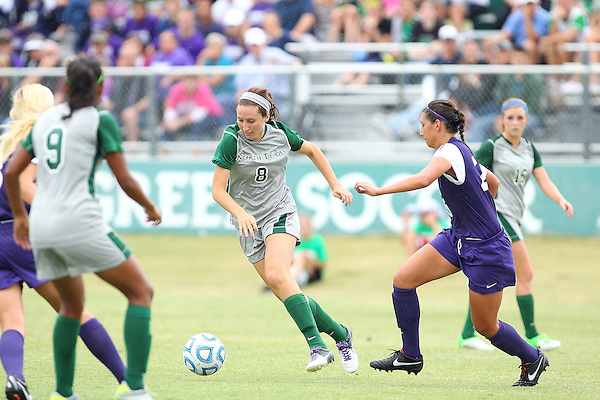 Denton, TX - SEPTEMBER 16: Leah Cox #8 of the North Texas Mean Green soccer in action against the Texas Christian University Horned Frogs at the Mean Green Village Soccer Field University in Denton on September 16, 2012 in Denton, Texas. (Photo by Rick Yeatts)
