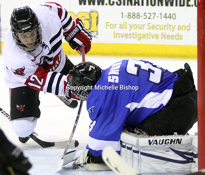 University of Nebraska Omaha's Brock Montpetit looks for a rebound as UAH goalie Clarke Saunders covers the puck. UNO beat Alabama-Huntsville 4-0 Friday night at Qwest Center Omaha.  (Photo by Michelle Bishop)
