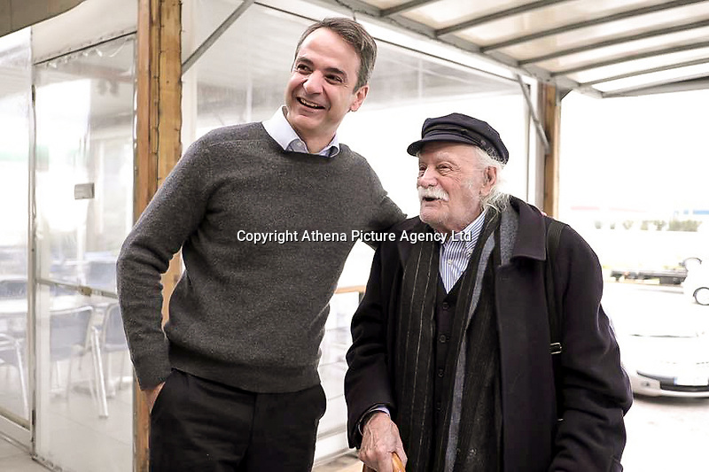 Pictured: Manolis Glezos with Greek Prime Minister Kyriakos Mitsotakis. STOCK PICTURE<br /> Re: Manolis Glezos, who took down a flag with a swastika from the Acropolis 30th of May 1941.