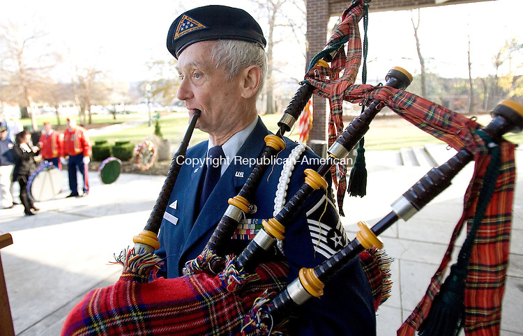 TORRINGTON, CT. 11 November 2012-111112SV11-Karcher Reynolds of Warren, Master Sgt. Retired, plays the bagpipes during the Veterans Day Ceremony at Coe Park in Torrington Sunday. .Steven Valenti Republican-American