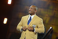 Canton, Ohio - August 1, 2014: Aeneas Williams dons his gold jacket during the Pro Football Hall of Fame's class of 2014 enshrinement dinner in Canton, Ohio  August 1, 2014. During his career, Williams had nine interceptions returned for a touchdown and was named to eight Pro Bowl teams.  (Photo by Don Baxter/Media Images International)