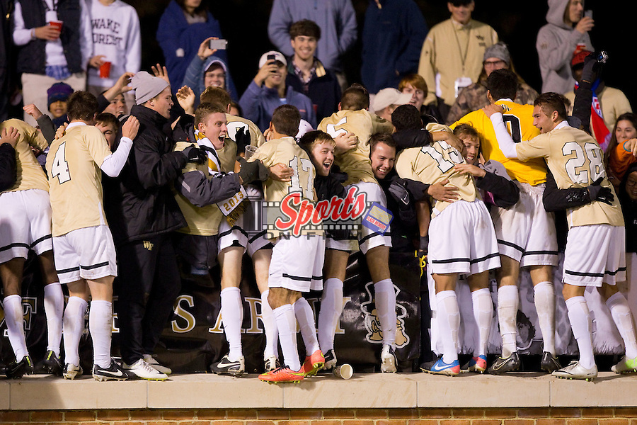 Kevin Politz (4), Shane Powell (29), John Schuman (17),  Sam Fink (5), Steven Echevarria (15), Tane Gent (28) and Alec Ferrell (0) of the Wake Forest Demon Deacons celebrates with fans after defeating the Louisville Cardinals 1-0 in overtime at Spry Soccer Stadium on November 1, 2014 in Winston-Salem, North Carolina.  (Brian Westerholt/Sports On Film)