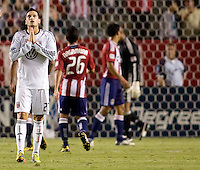 DC United midfielder Santino Quaranta prays for help. CD Chivas USA beat DC United 1-0 at Home Depot Center stadium in Carson, California on Sunday August 29, 2010.
