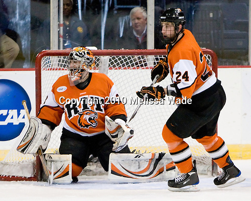 Jared DeMichiel (RIT - 33), Chris Haltigin (RIT - 24) - The Rochester Institute of Technology (RIT) Tigers defeated the Denver University Pioneers 2-1 on Friday, March 26, 2010, in their NCAA East Regional semi-final at the Times Union Center in Albany, New York.