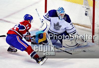 10 April 2010: Toronto Maple Leafs' goaltender Jean-Sebastien Giguere makes a second period save on Montreal Canadiens' center Tomas Plekanec at the Bell Centre in Montreal, Quebec, Canada. The Maple Leafs defeated the Canadiens 4-3 in sudden death overtime. Mandatory Credit: Ed Wolfstein Photo