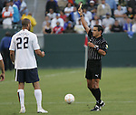 7 June 2007: Referee Jose Pineda (HON) issues a yellow card to Oguchi Onyewu. The United States Men's National Team defeated the National Team of Guatemala 1-0 at the Home Depot Center in Carson, California in a first round game in the CONCACAF Gold Cup...