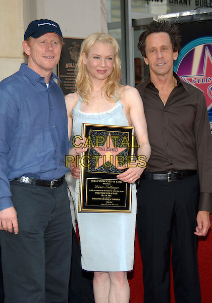 RON HOWARD, RENEE ZELLWEGER & BRIAN GRAZER.Honored with a Star on the Hollywood Walk of Fame for Her Achievements in Film on Hollywood Boulevard. .May 24th, 2005.Photo Credit: Jacqui Wong/AdMedia.half length blue dress plaque baseball cap hat.www.capitalpictures.com.sales@capitalpictures.com.© Capital Pictures.