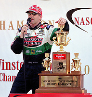 Bobby Labonte addresses the crowd after clinching the 2000 WInston Cup Championship at Homestead-Miami Speedway in November 2000. (Photo by Brian Cleary)