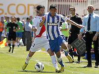 Rayo Vallecano's Chori Dominguez (l) and Real Sociedad's Carlos Vela during La Liga match.April 14,2013. (ALTERPHOTOS/Acero)