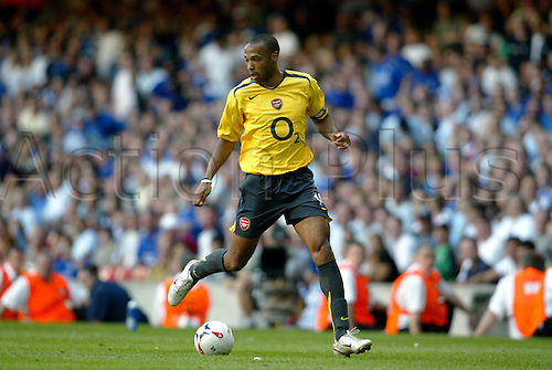 7 August 2005: Arsenal striker and captain Thierry Henry runs with the ball during the FA Community Shield played between Arsenal and Chelsea at the Millennium Stadium, Cardiff. Chelsea won the game 2-1. Photo: Neil Tingle/Actionplus..050807 football soccer player