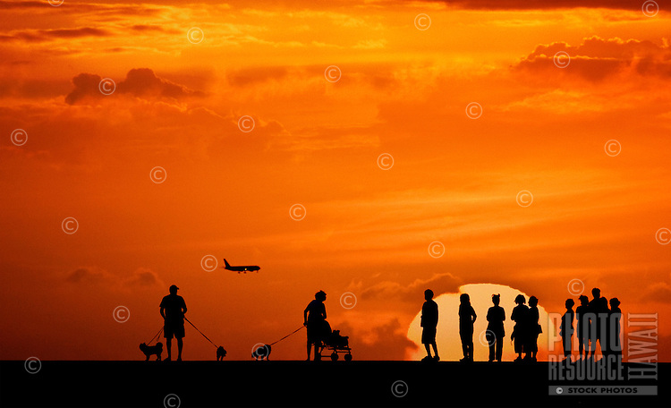 A group of onlookers enjoying an unforgettable sunset.