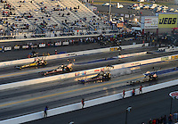 Apr. 13, 2012; Concord, NC, USA: NHRA top fuel dragster drivers (right to left) Khalid Albalooshi , Pat Dakin , Steve Torrence and Morgan Lucas race four-wide during qualifying for the Four Wide Nationals at zMax Dragway. Mandatory Credit: Mark J. Rebilas-