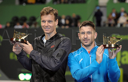 03.01.2014. Doha, Qatar.  Tomas Berdych (L) and Jan Hajek of Czech Republic pose with their trophies after the men s doules final against Alexander Peya of Austria and Bruno Soares of Brazil in Qatar Open tennis tournament, Jan. 3, 2014. Tomas Berdych and Jan Hajek won 2-0.