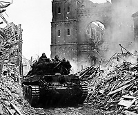 BNPS.co.uk (01202 558833)<br /> NARA/BNPS<br /> <br /> A Cromwell tank advances through the rubble of Udem. <br /> <br /> Remarkable rarely seen photos of heroic Allied soldiers fighting their way across Europe before crossing the River Rhine 75 years ago feature in a new book.<br /> <br /> They are published in Images of War, Montgomery's Rhine Crossing, which tells the story of the legendary offensive, nicknamed Operation Plunder, in March 1945.<br /> <br /> On the night of March 23, Field Marshal Bernard Montgomery's 21st Army Group launched a massive artillery, amphibious and airborne assault to breach the historic defensive water barrier protecting northern Germany.<br /> <br /> At the same time, the Americans, with the support of the British 6th Airborne Division, set in motion Operation Varsity - involving 16,000 paratroopers - on the east bank of the Rhine. They were dropped here to seize bridges to prevent German reinforcements from contesting the bridgeheads.<br /> <br /> Fierce fighting ensued, with much bloodshed on both sides as the Allies met determined resistance from machine gun nests. But the daring operation proved successful, helping to considerably shorten the war - the Nazis surrendered just six weeks later.