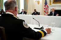United States President Donald J. Trump makes remarks as he participates in a roundtable with law enforcement officials in the State Dining Room of the White House, in Washington, DC, Monday, June, 8, 2020. From left to right: US Attorney General William P. Barr, Attorney Daniel J, Cameron (Republican of Kentucky), and President Trump. <br /> Credit: Doug Mills / Pool via CNP/AdMedia