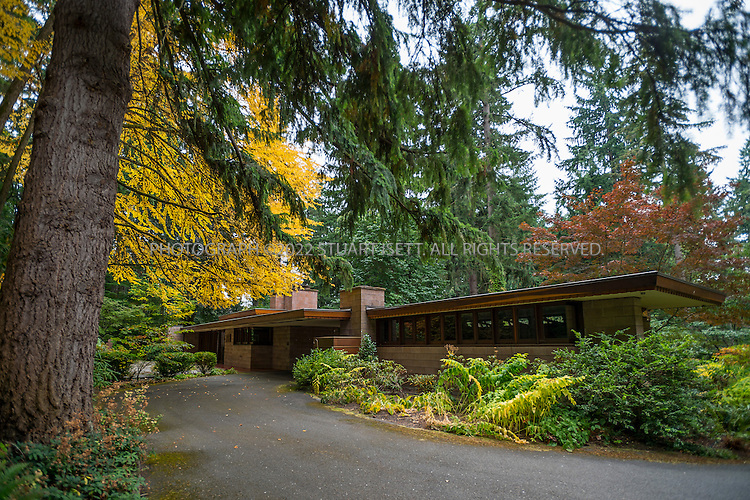 "10/9/2012--Sammamish, WA, USA..VIEW: Exterior showing back of house with main entrance...Architect Frank Lloyd Wright planned his ""Usonian"" homes to be affordable for middle-class families. The 1,9500 square foot Brandes home is for sale in Sammamish, Washington (30 minutes from Seattle) at $1.39 million. It features three bedrooms, two bathrooms and a small, separate office/study space...The home was built in 1952, and has redwood trim and Wright's original furniture and some garden sculptures by Wright. It's one of only three Frank Lloyd Wright homes near Seattle...©2012 Stuart Isett. All rights reserved."