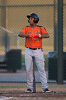 AZL Giants Orange second baseman Wascer De Leon (34) adjusts his batting gloves during an Arizona League game against the AZL Athletics at Lew Wolff Training Complex on June 25, 2018 in Mesa, Arizona. AZL Giants Orange defeated the AZL Athletics 7-5. (Zachary Lucy/Four Seam Images)